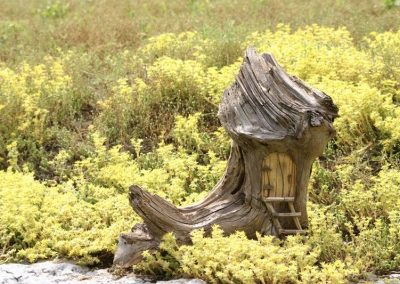 Fairy House Boot (carved, tree root) by Bill van Koot