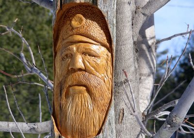 Mountain Man (carved, cedar rail) by Bill van Koot